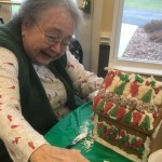 Sue Haney having a blast decorating her Gingerbread House.